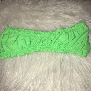 Ruffled neon green swimsuit top